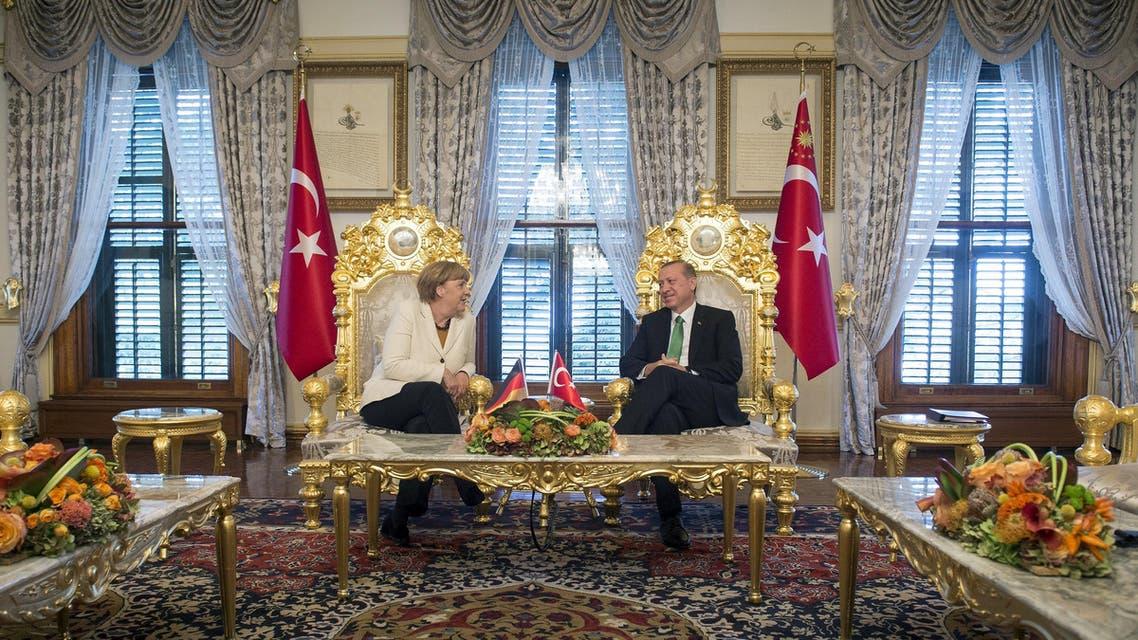 Turkish President Tayyip Erdogan (R) listens to German Chancellor Angela Merkel during their meeting in Istanbul, Turkey, October 18, 2015 REUTERS