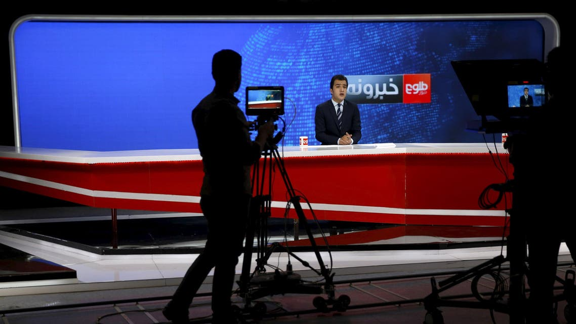 """A cameraman films a news anchor at Tolo News studio, in Kabul, Afghanistan October 18, 2015. Already forced to operate in one of the world's most hostile environments for journalists, Afghan television stations are now being openly targeted by Islamist insurgents in a widening insurgency that threatens cities across the country. Amid reports of summary executions, kidnappings and other abuses, the Taliban also issued a grim warning to two Afghan television stations, Tolo News and 1 TV, designating them as """"military objectives"""". REUTERS/Ahmad Masood"""