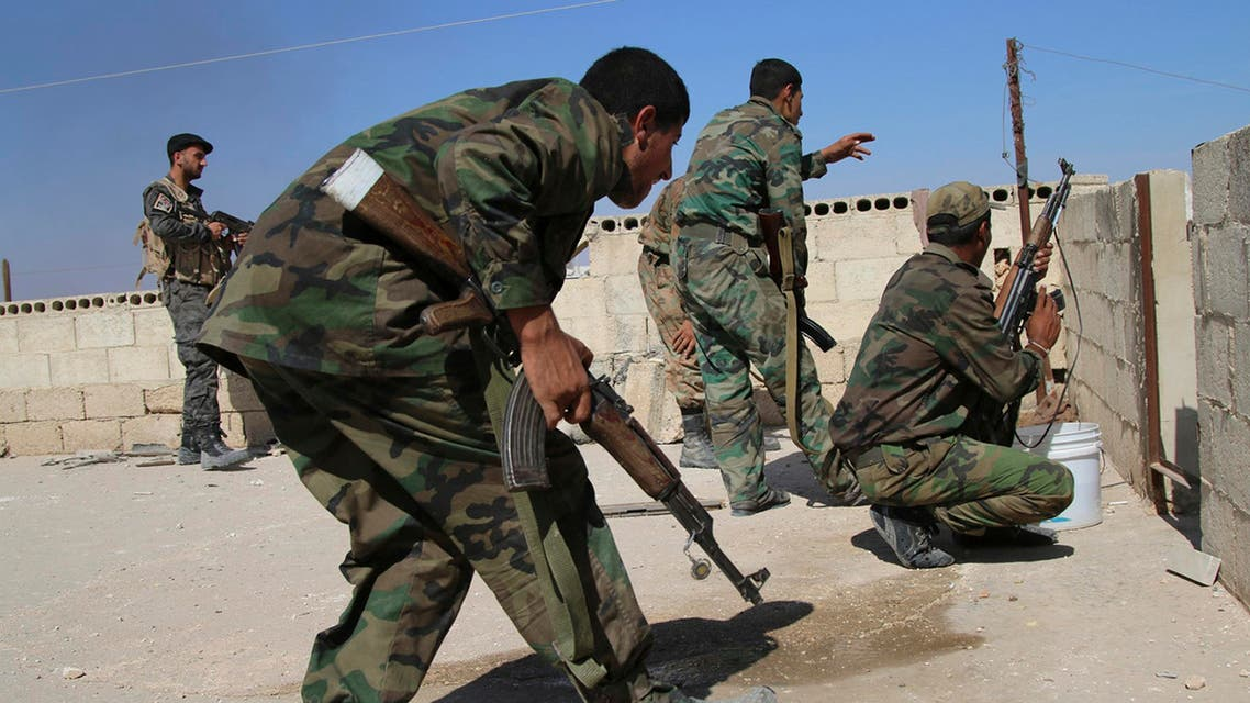 FILE - In this photo taken on Sunday, Oct. 11, 2015, Syrian soldiers fire repelling an attack in Achan, Hama province, Syria. Russian jets intensified their airstrikes Monday in the central Syrian province as government and allied troops pushed out insurgents from local villages to expand their control of the area, activists and a military statement said. (Alexander Kots/Komsomolskaya Pravda via AP, File)