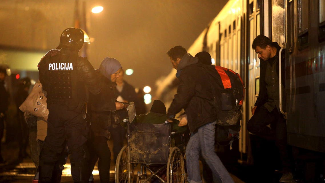 Migrants exit a train at a train station in Sredisce ob Dravi, Slovenia October 17, 2015. Migrants streaming across the Balkans reached Slovenia on Saturday, diverted overnight by the closure of Hungary's border with Croatia in the latest demonstration of Europe's disjointed response to the flow of people reaching its borders. Croatia began directing migrants west to Slovenia, which said they would be registered before continuing their journey to Austria and Germany, the preferred destination of the vast majority, many of them Syrians fleeing war. REUTERS/Srdjan Zivulovic TPX IMAGES OF THE DAY