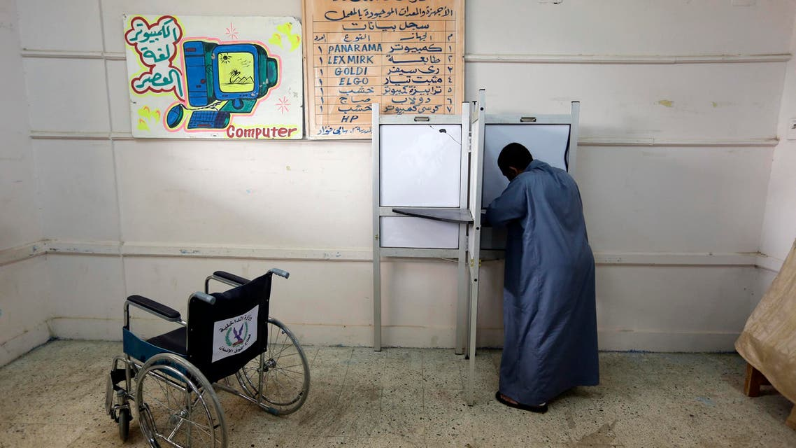A voter casts his ballot at a polling station during the first round of the parliamentary election, in the village of Kerdasa, Giza, Cairo, Egypt, Sunday, Oct. 18, 2015. (AP)
