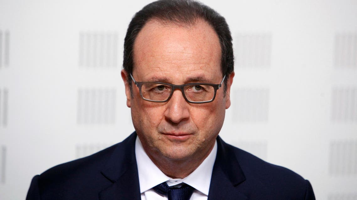 "France's President Francois Hollande gives a speech during a visit at the ""Ligue Contre le Cancer"" (League Against Cancer), in Paris, Tuesday, March 24, 2015.ap"