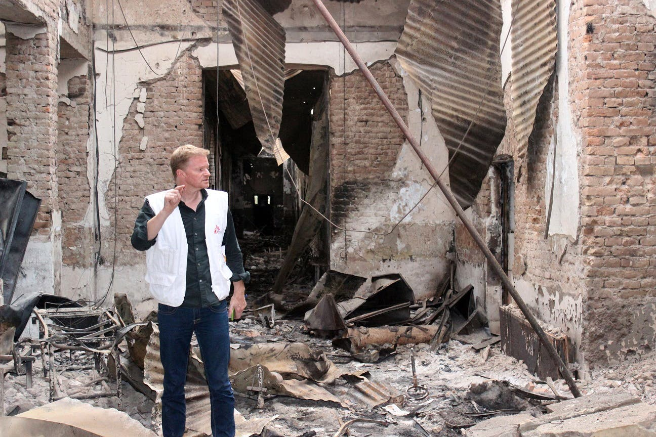 In this Friday, Oct. 16, 2015 photo, Christopher Stokes, the general director of the medical charity, Doctors Without Borders, which is also known by its French abbreviation MSF, stands amid the charred remains of the organization's hospital, after it was hit by a U.S. airstrike in Kunduz, Afghanistan.ap