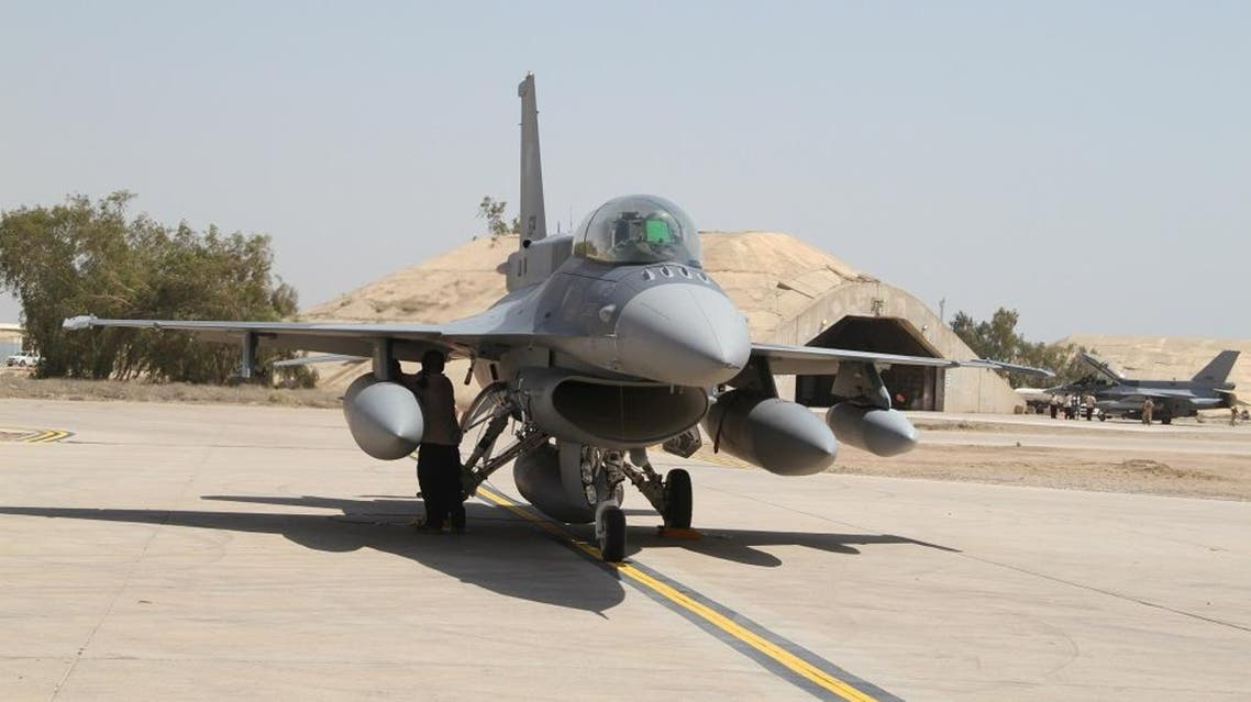 Two of four new U.S.- made F-16 fighter jets stand on the tarmac upon their arrival to Balad air base, 75 kilometers (45 miles) north of Baghdad, Iraq, Monday, July 13, 2015. (AP Photo)