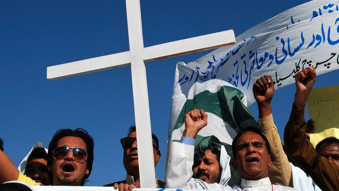 Pakistani Christians chant slogans during a demonstration to condemn the killing of a Christian couple, in Peshawar, Pakistan, Sunday, Nov. 9, 2014.