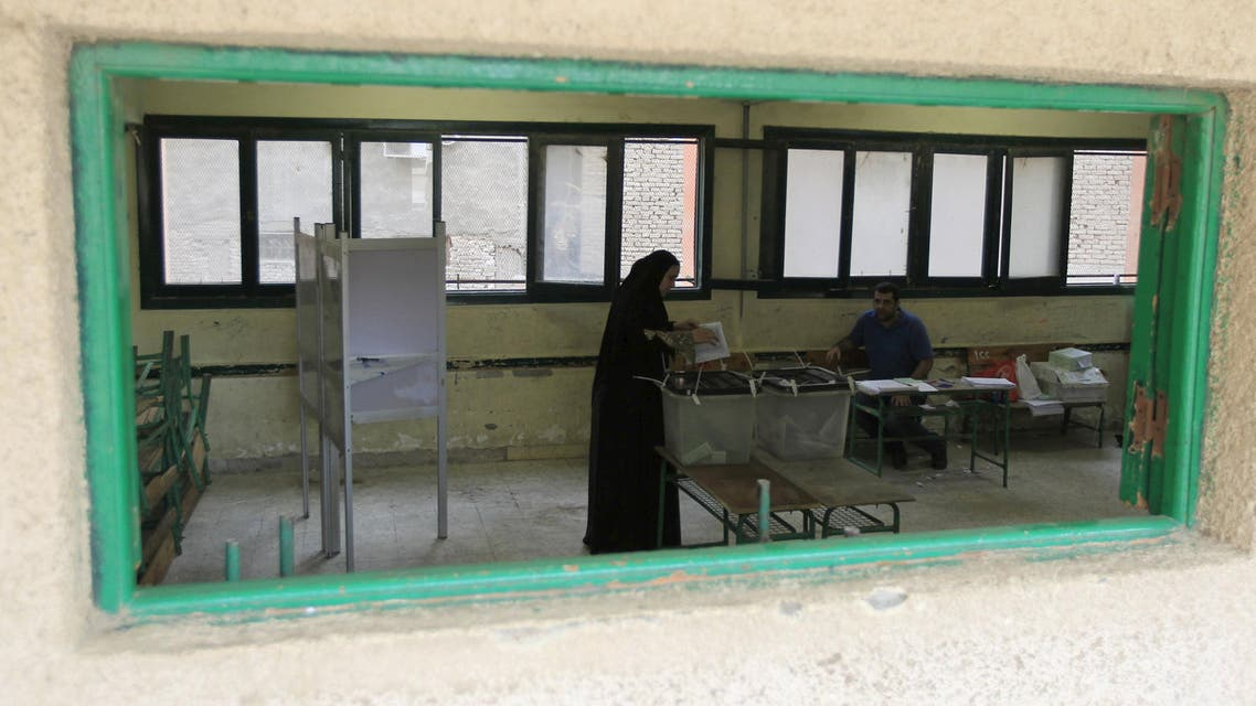 A woman casts her vote during parliamentary elections at a voting centre in Giza governorate, Egypt. (Reuters)