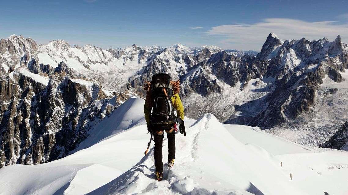 In this file photo taken on Oct. 12, 2011, an alpinist heads down a ridge on the Aiguille du Midi. (AP)