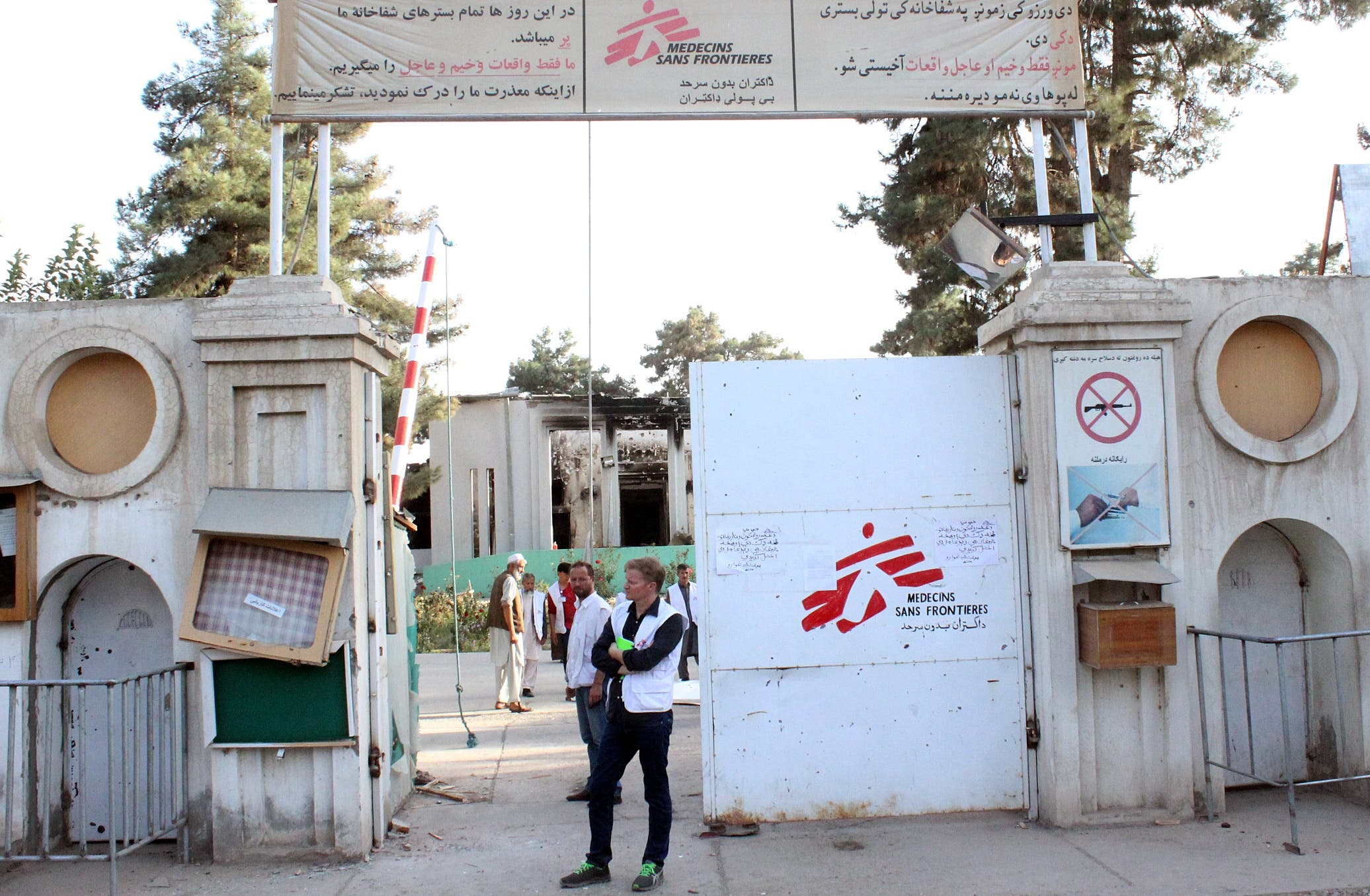In this Thursday, Oct. 15, 2015 photo, Christopher Stokes, the general director of medical charity Doctors Without Borders, which is also known by its French abbreviation MSF, stands at the gate of the organization's hospital, after it was hit by a U.S. airstrike, in Kunduz, Afghanistan.