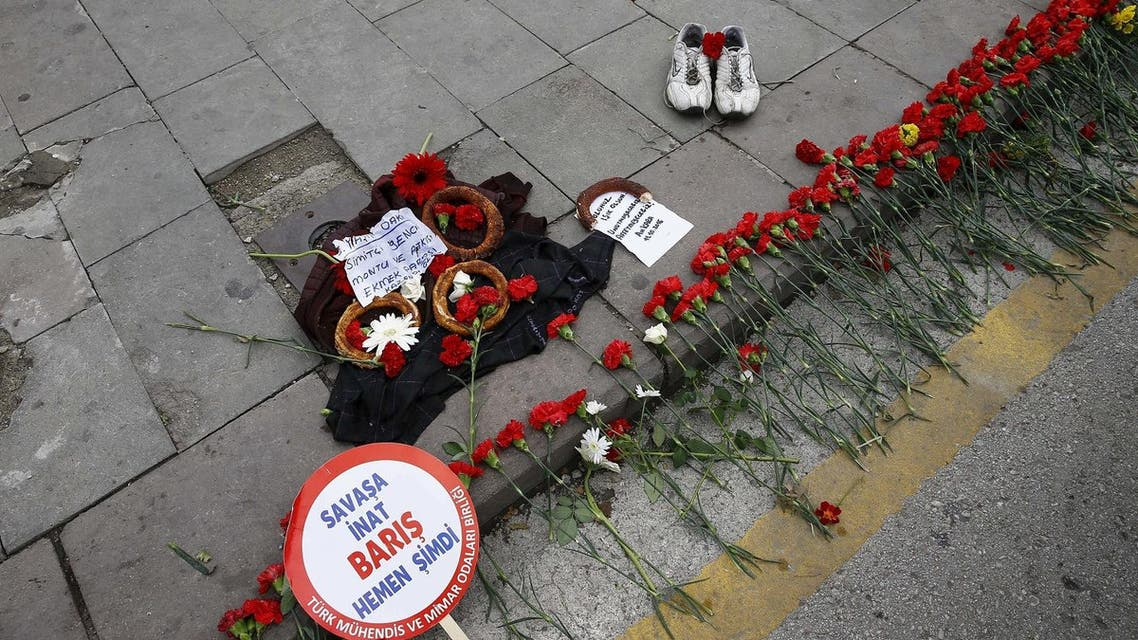 A pair of shoes, belonging to a street vendor who was selling Turkish traditional bagel or simit, is placed at the bombing scene. (Reuters)