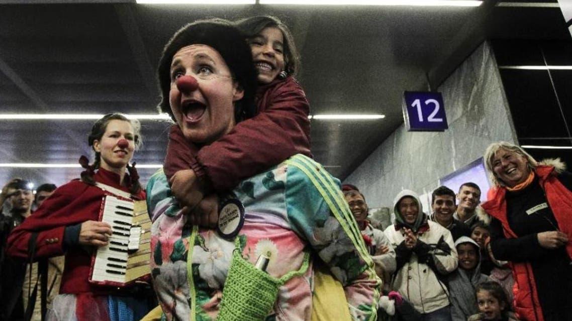 Red nose clown member AFP