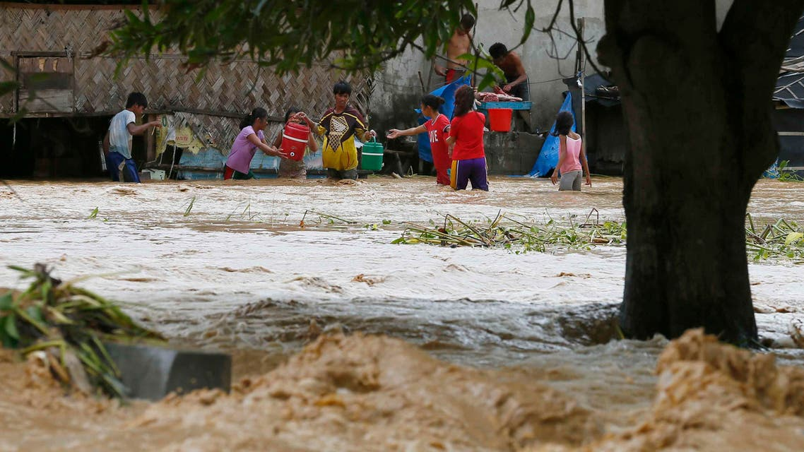 Trapped residents carry their household items as they evacuate to safer grounds amidst raging floodwaters brought about by Typhoon Koppu at Zaragosa township, Nueva Ecija province, north of Manila, Philippines Monday, Oct. 19, 2015. ap