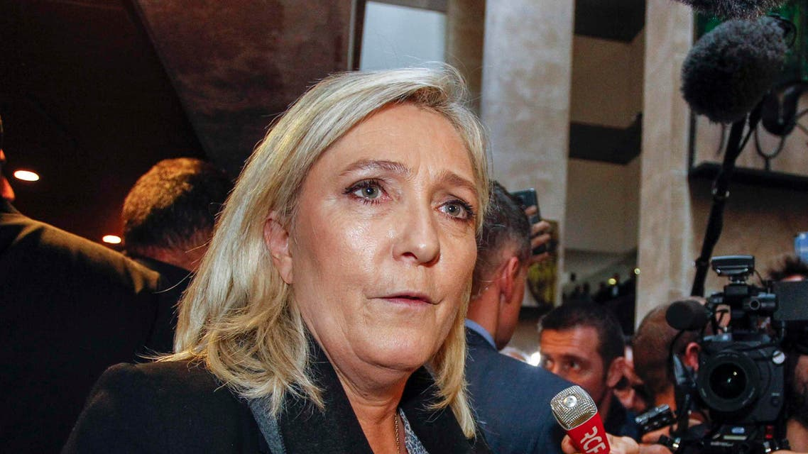 """French National Front political party leader Marine Le Pen speaks to journalists as she leaves the courthouse in Lyon, France, October 20, 2015. France's far-right National Front party leader Marine Le Pen said she was the victim of """"judicial persecution"""" as she went on trial on Tuesday for comparing Muslim street prayers to wartime Nazi occupation. REUTERS/Emmanuel Foudrot"""