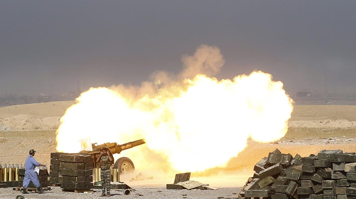Shi'ite fighters launch artillery toward Islamic State militants in al-Fatha, northeast of Baiji, October 18, 2015. Iraqi forces backed by Shi'ite militia fighters say they have retaken a mountain palace complex of former President Saddam Hussein from Islamic State fighters, as government forces push ahead on a major offensive against the insurgents. REUTERS/Thaier Al-Sudani