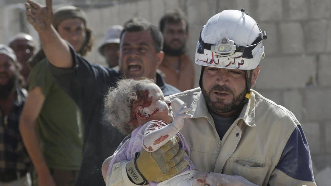 ATTENTION EDITORS - VISUAL COVERAGE OF SCENES OF INJURY OR DEATHA civil defence member carries an injured baby that survived from under debris at a site hit by what activists said was an airstrike by forces loyal to Syria's President Bashar al-Assad, in the town of Marshamsha, in the southern countryside of Idlib, Syria October 20, 2015. REUTERS/Khalil AshawiFOR EDITORIAL USE ONLY. NO RESALES. NO ARCHIVE.