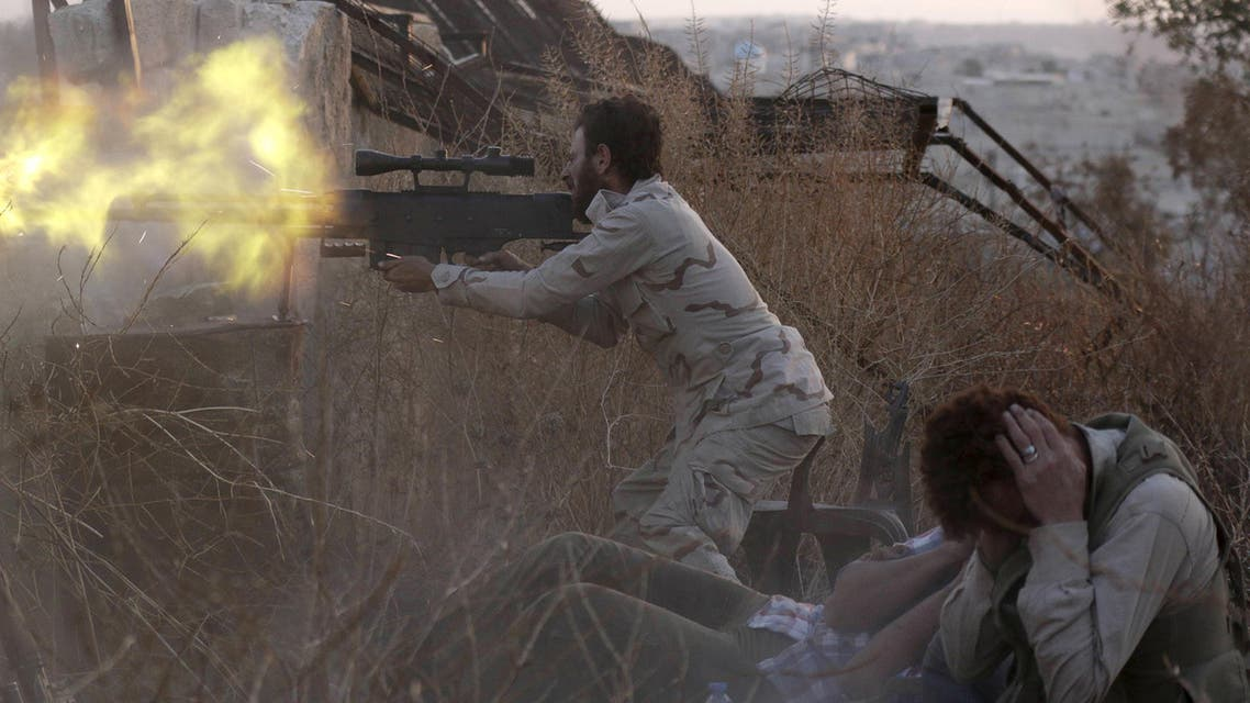 A rebel fighter fires a weapon as a fellow fighter covers his ears during clashes with forces loyal to Syria's President Bashar al-Assad on the frontline of Aleppo's Sheikh Saeed neighbourhood May 23, 2015. (Reuters)