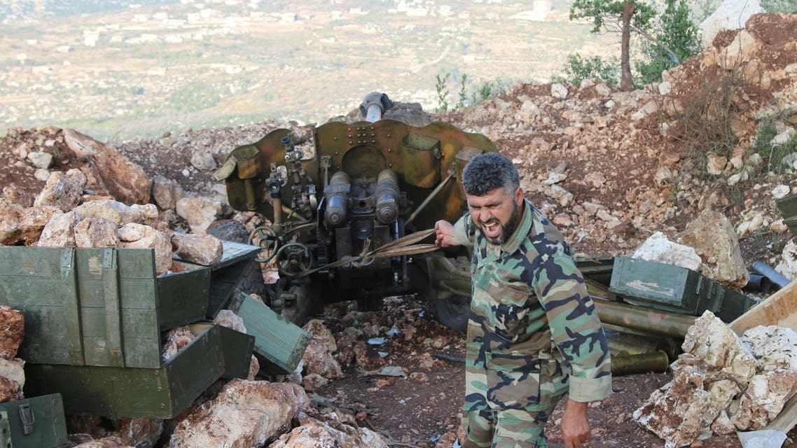 In this photo taken on Saturday, Oct. 10, 2015, a Syrian army soldier fires a cannon in Latakia province, about 12 from the border with Turkey in Syria. Backed by Russian airstrikes, the Syrian army has launched an offensive in central and northwestern regions. (Alexander Kots/Komsomolskaya Pravda via AP)