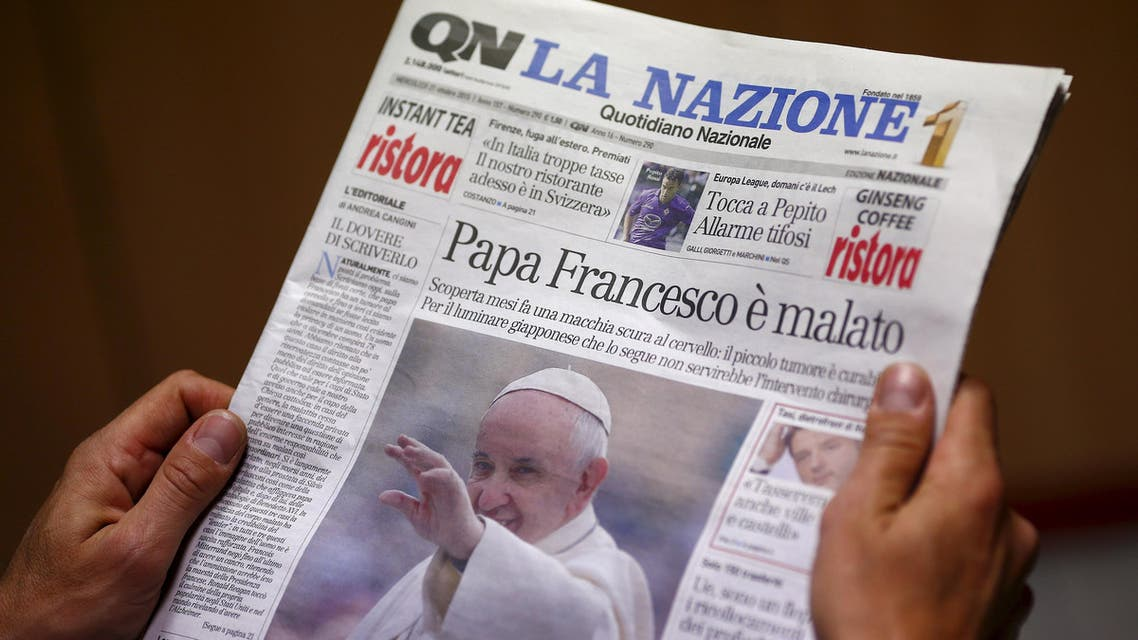 """A man reads the Italian newspaper """"Quotidiano Nazionale"""" in Rome, Italy October 21, 2015. The Vatican denied on Wednesday an Italian media report that Pope Francis has a benign brain tumor. The newspaper Quotidiano Nazionale, a national paper based in central Italy, reported on its front page on Wednesday that the 78-year-old pope had secretly flown by helicopter to a small Tuscan town """"some time ago"""" to see a Japanese doctor. REUTERS/Tony GentileFOR EDITORIAL USE ONLY. NO RESALES. NO ARCHIVE TPX IMAGES OF THE DAY"""