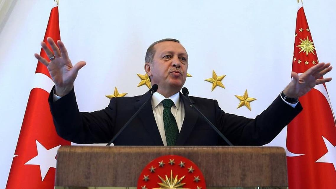 Turkish President Recep Tayyip Erdogan addresses people from southeastern Turkey, in Ankara, Turkey, Tuesday, Oct. 20, 2015. Critics accuse Erdogan of organizing rallies in Turkey and Europe to drum up votes for the ruling Justice and Development Party before Nov. 1 general elections, in breach of laws that require him to be neutral.(AP Photo/Presidential Press Service, Pool )