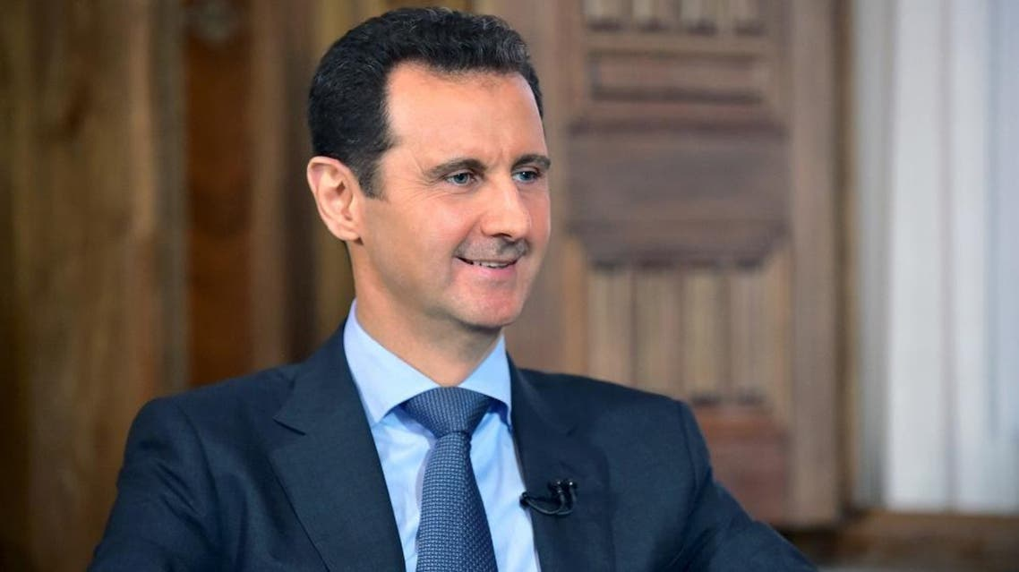 Assad answers questions during an interview with al-Manar's journalist Amro Nassef, in Damascus, Syria, in this handout photograph released by Syria's national news agency SANA on August 25, 2015. (Reuters)