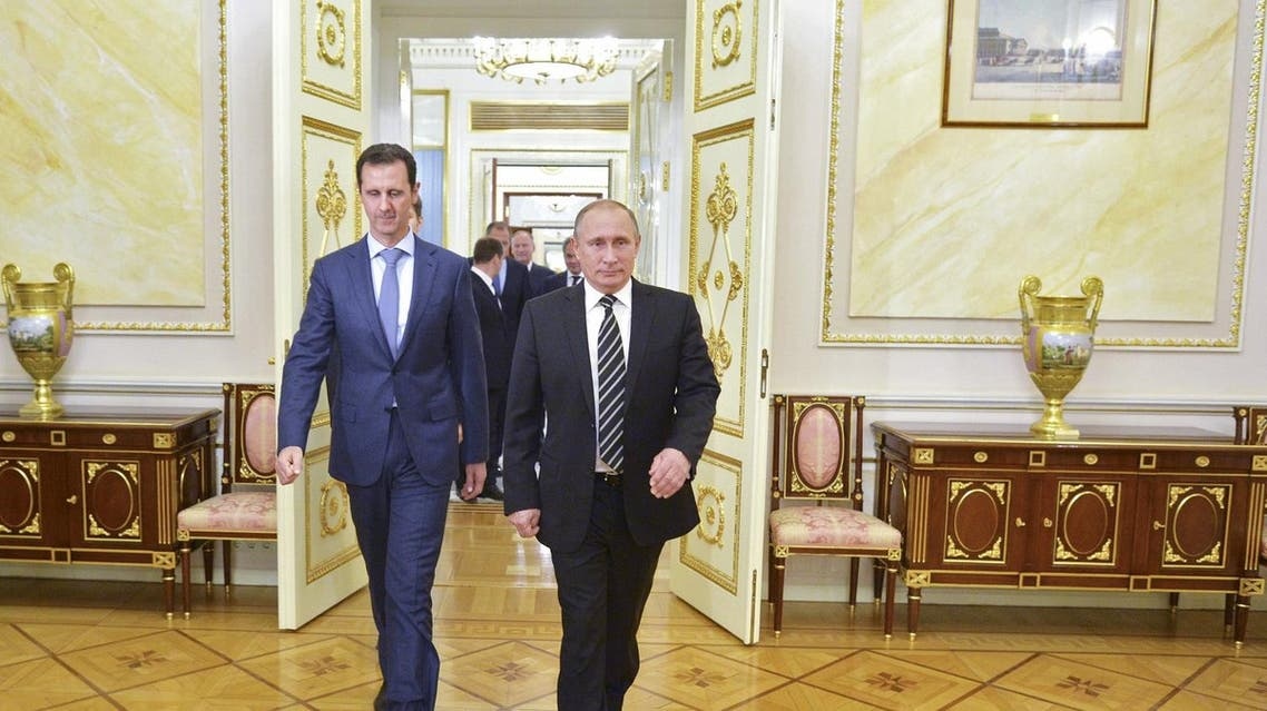 Russian President Putin and Syrian President Assad enter a hall during a meeting at the Kremlin in Moscow