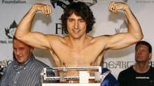 Photos of shirtless, muscle-flexing new Canadian PM eclipse policy talk