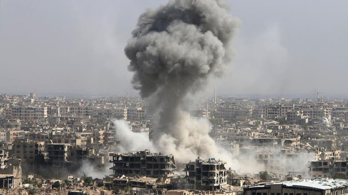 In this photo taken on Wednesday, Oct. 14, 2015, smoke rises after shelling by the Syrian army in Jobar, Damascus, Syria. Backed by Russian airstrikes, the Syrian army has launched an offensive in central and northwestern regions. (Alexander Kots/Komsomolskaya Pravda via AP) RUSSIA OUT