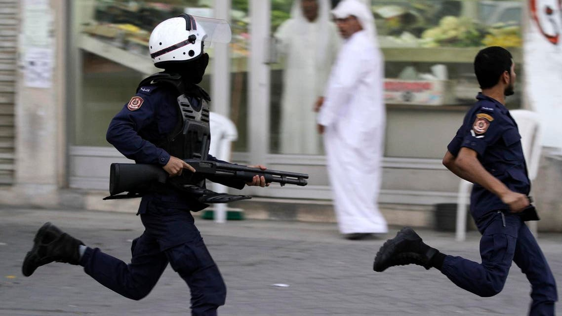 Riot police chase Bahraini anti-government protesters during a demonstration in Malkiya. (File photo: AP)