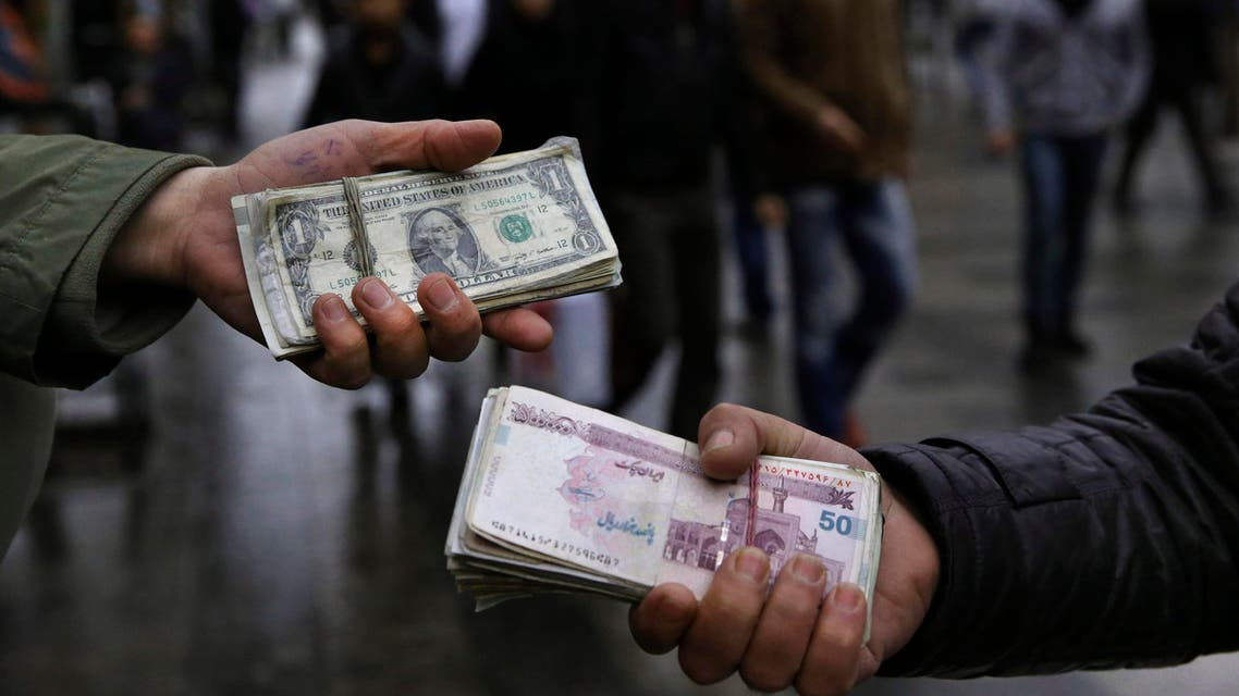 Iranian street money exchangers show currencies at Tehran's old main bazaar (AP)