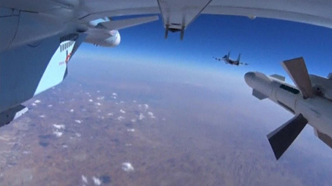 A frame grab taken from footage from a camera under a plane, released by Russia's Defence Ministry October 22, 2015, shows military jets of the Russian air force during a sortie at an unknown location in Syria. REUTERS/Ministry of Defence of the Russian Federation/Handout via Reuters ATTENTION EDITORS - THIS PICTURE WAS PROVIDED BY A THIRD PARTY. REUTERS IS UNABLE TO INDEPENDENTLY VERIFY THE AUTHENTICITY, CONTENT, LOCATION OR DATE OF THIS IMAGE. EDITORIAL USE ONLY. NOT FOR SALE FOR MARKETING OR ADVERTISING CAMPAIGNS. NO RESALES. NO ARCHIVE. THIS PICTURE IS DISTRIBUTED EXACTLY AS RECEIVED BY REUTERS, AS A SERVICE TO CLIENTS