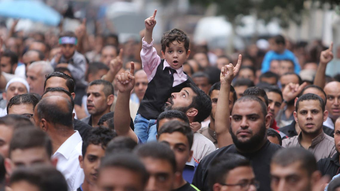 Palestinians take part in an anti Israel rally, in the central Gaza Strip October 23, 2015. (Reuters)