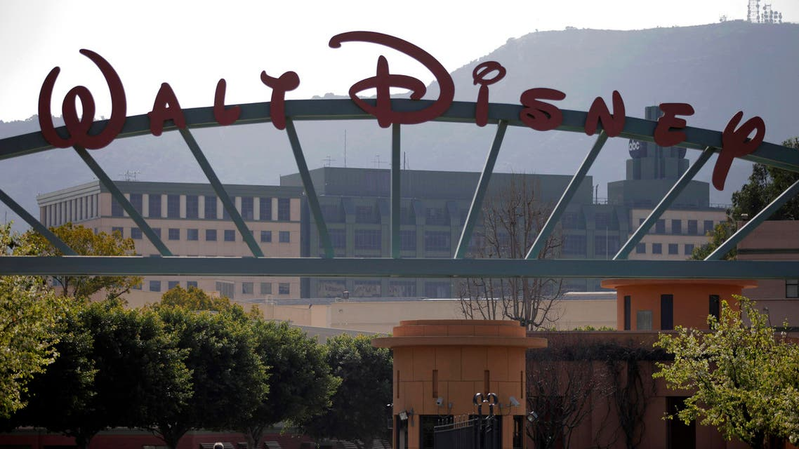 People stand near the entrance to the Walt Disney Studios is seen in Burbank , Calif., Tuesday, Feb. 8, 2011. Walt Disney Co. releases quarterly financial earnings Tuesday, after the market close.(AP