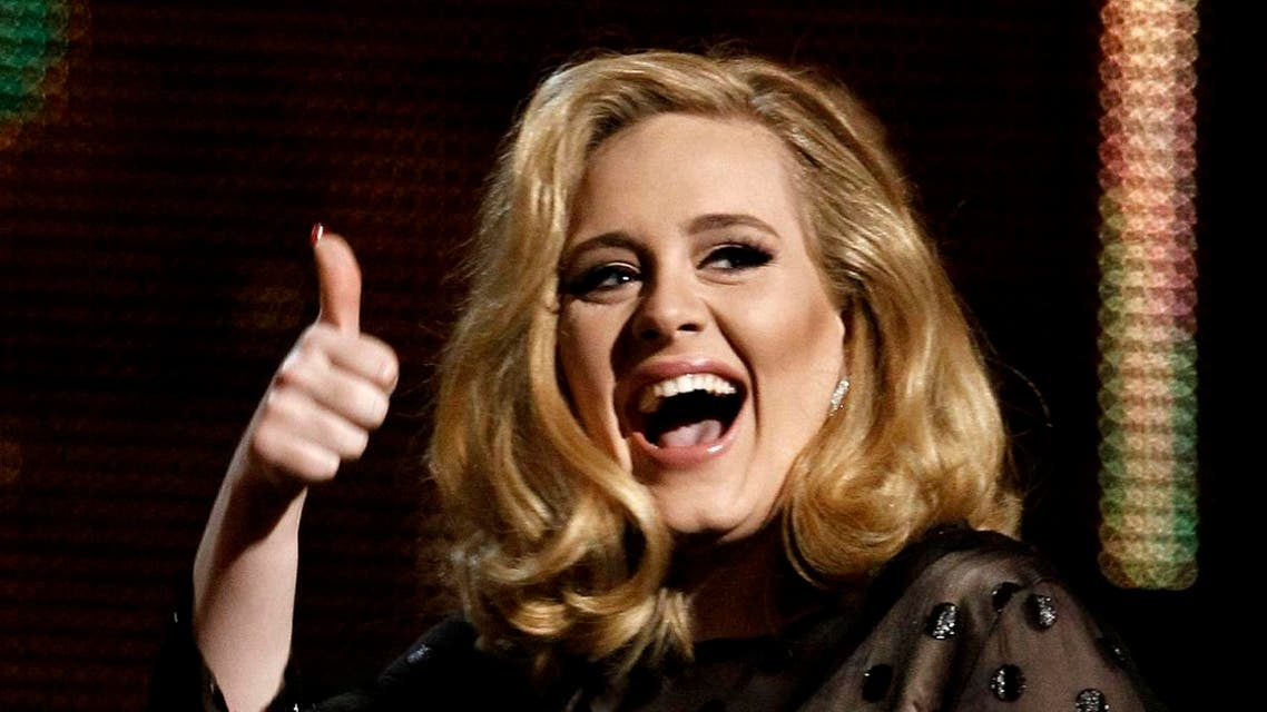 "Adele accepts the award for record of the year for ""Rolling in the Deep"" during the 54th annual Grammy Awards. (AP)"