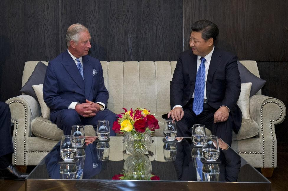 Prince Charles speaks with Xi Jinping at the Mandarin Oriental hotel in London. (Reuters)