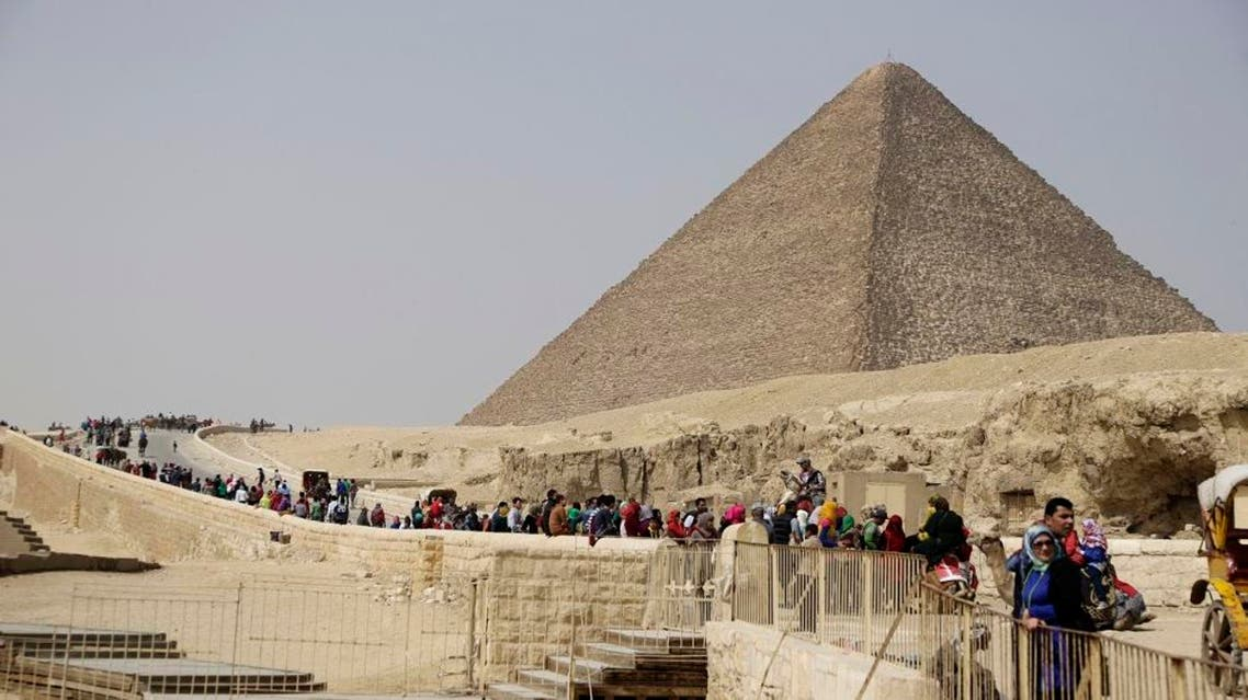 Tourists visit the historical site of the Giza Pyramids in Giza, near Cairo, Egypt, Wednesday, March 5, 2014. AP