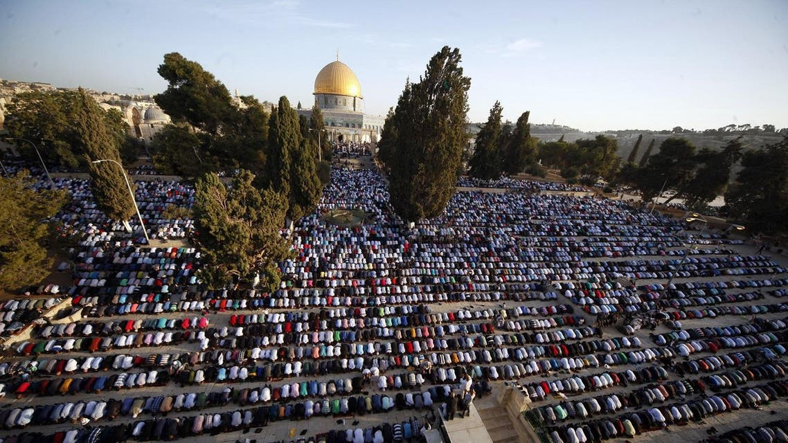 Palestinians pray during the Muslim holiday of Eid al-Adha, near the Dome of the Rock Mosque in the Al Aqsa Mosque compound in Jerusalem's old city on Sept. 24. (AP)