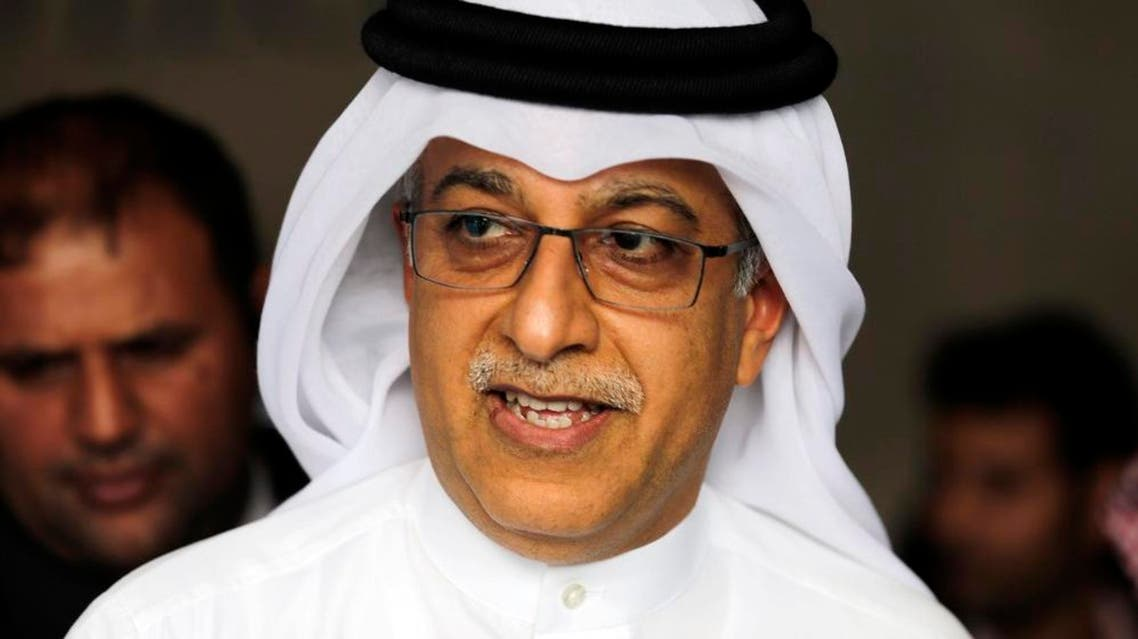 Asian Football Confederation President Sheikh Salman bin Ebrahim Al Khalifa leaves the AFC Congress in Manama, Bahrain, Thursday, April 30, 2015. Sheikh Salman, who stood unopposed, was re-elected by acclamation for a four-year term until 2019. (AP Photo/Hasan Jamali)