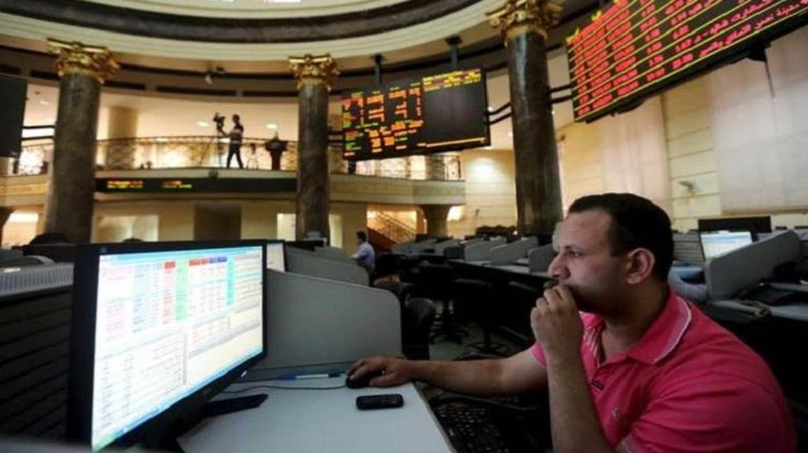 A trader works at the Egyptian stock exchange in Cairo, August 23, 2015. (Reuters)