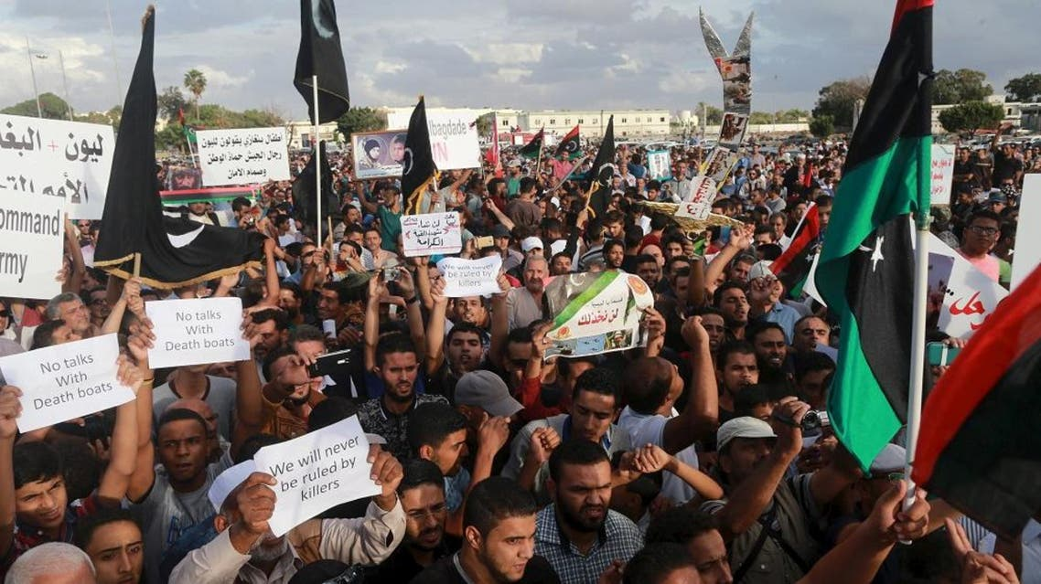 People take part in a protest against candidates for a national unity government proposed by U.N. envoy for Libya Bernardino Leon, in Benghazi, Libya October 23, 2015. REU