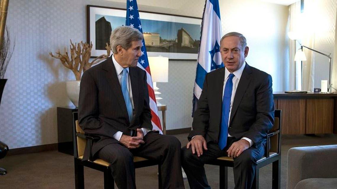 U.S. Secretary of State John Kerry, left, speaks with Israeli Prime Minister Benjamin Netanyahu during a meeting in Berlin. (AP)