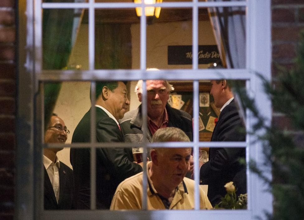 David Cameron and Xi Jinping are seen drinking beer inside The Plough At Cadsden pub in Cadsden. (Reuters)
