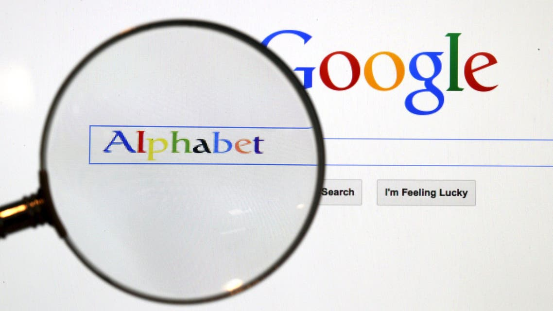 Google search page is seen through a magnifying glass in this photo illustration taken Tuesday in Berlin. Google Inc. is changing its operating structure by setting up a new company called Alphabet Inc., which will include the search business and other units.(Reuters)