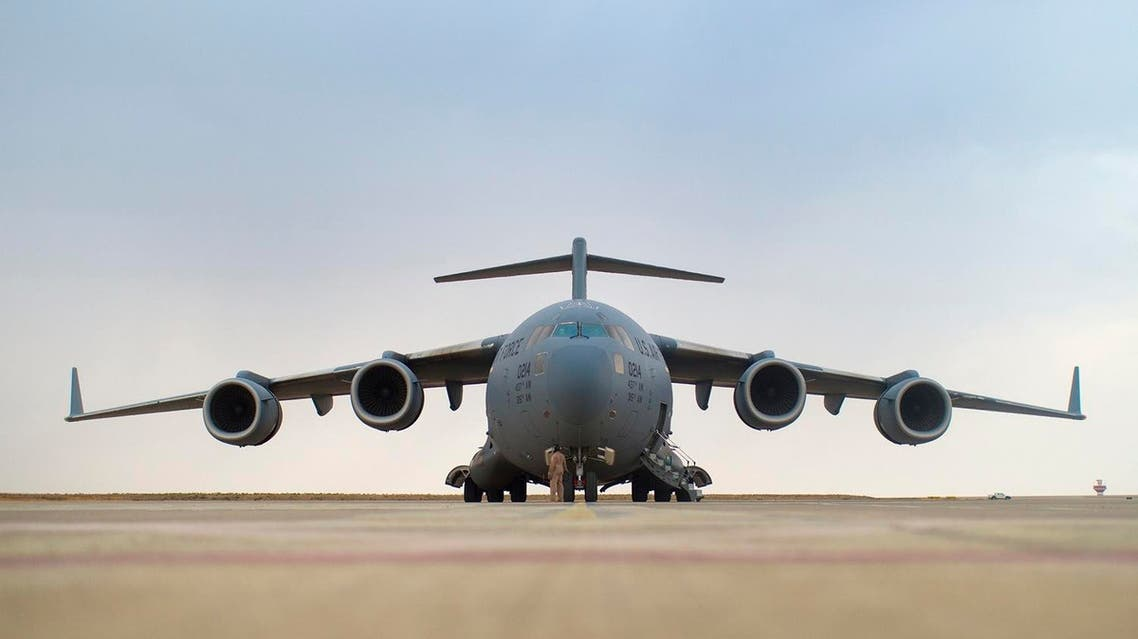 A crew member checks a U.S. Air Force C-17 at the airport in Irbil. (Reuters)
