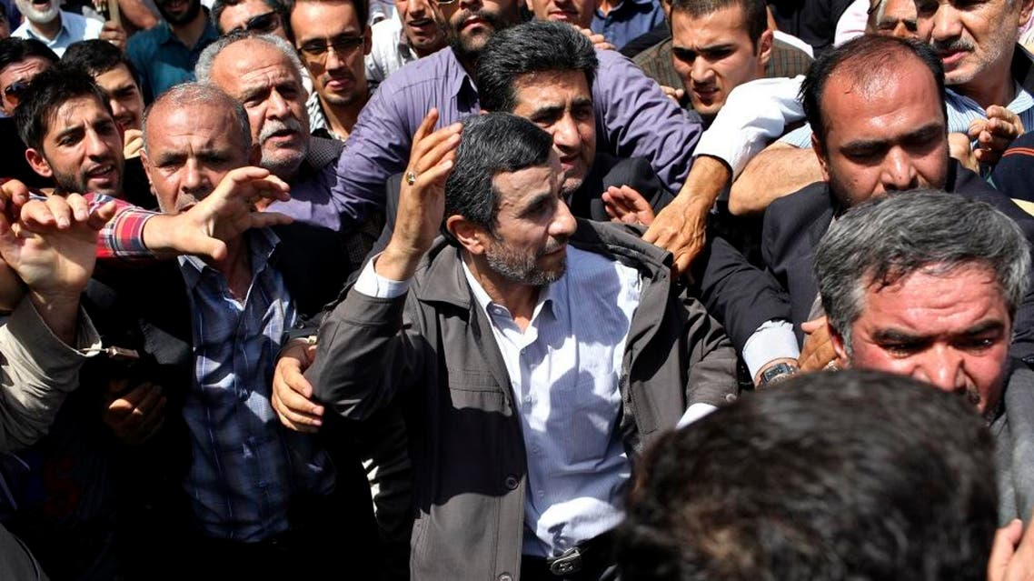 Escorted by his bodyguards, Iranian President Mahmoud Ahmadinejad waves to his well wishers at a pro-Palestinian rally in Tehran. (File photo: AP)