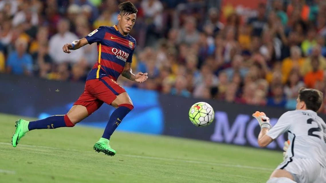 Barcelona's Neymar, left, challenges Roma goalkeeper Szczesny during the Joan Gamper trophy soccer match between FC Barcelona and AS Roma at the Camp Nou stadium in Barcelona, Spain, Wednesday, Aug. 5, 2015. (AP