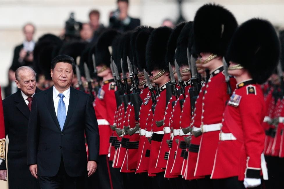 Xi Jinping and Prince Philip review an honor guard during his official welcoming ceremony in London. (Reuters)