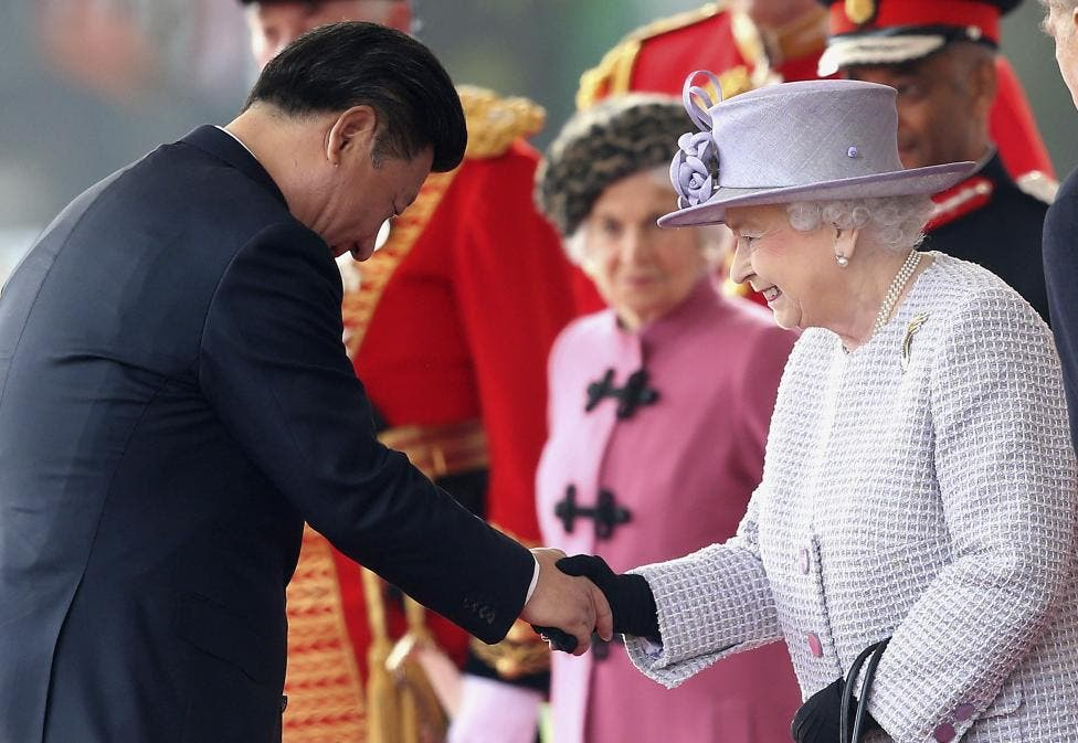 Queen Elizabeth greets Xi Jinping during a ceremonial welcome at Horse Guards Parade in London. (Reuters)
