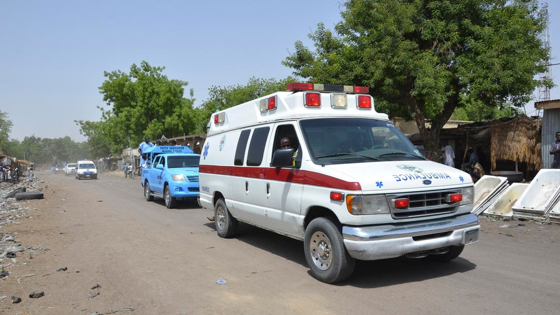 An ambulance and security cars drive to the site of a suicide bomb attack at a market in Maiduguri, Nigeria, Tuesday, June 2, 2015. AP