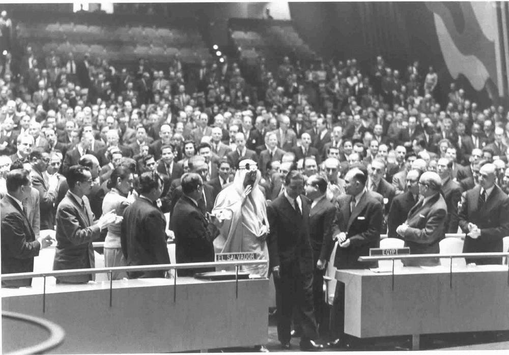King Saud of Saudi Arabia, is shown picture ascending to the speaker's rostrum, escorted by Prince Wan Waithayakon, while receiving a standing ovation, at the United Nations on Jan. 29, 1957
