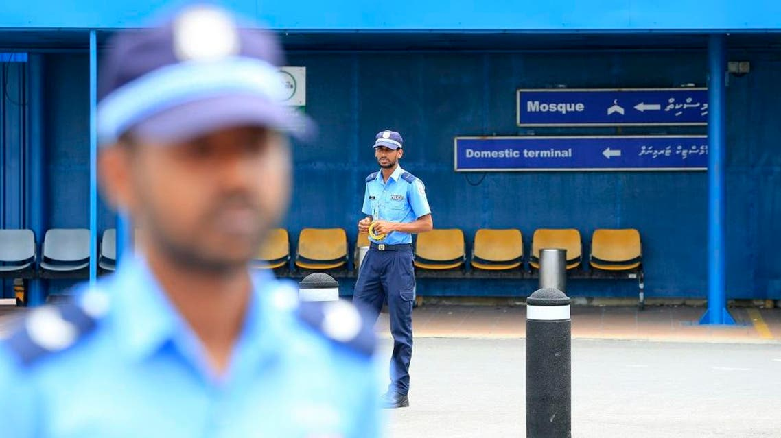 Police cordon off an area before the arrival of Vice President Ahmed Adheeb at the International Airport in Male, Maldives, Saturday, Oct. 24, 2015. Police say Adeeb has been arrested on suspicion of links to a blast on the presidential boat last month. (AP Photo/Sinan Hussain)