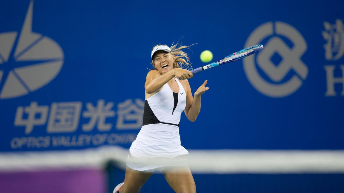 Russia's Maria Sharapova plays against Czech Republic's Barbora Strycova during their women's singles match at the Wuhan Open tennis tournament, Hubei province, China, September 28, 2015